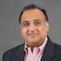headshot profile photo of Ajoy Sharma