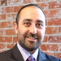 headshot profile photo of Greg Khachatrian