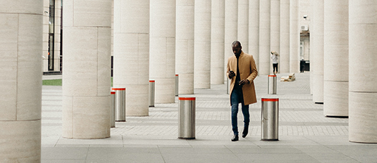 financial transaction business person walking outside in a city
